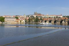 Spring Prague gothic Castle with the Lesser Town above River Vltava in the sunny Day, Czech Republic. Spring Prague gothic Castle with the Lesser Town above stock photo