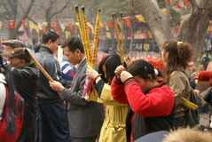 Spring Praying in China. In China, people would like to go to temples when spring comes. They pray to Buddha to bless them have a lucky future in the new year Royalty Free Stock Photo