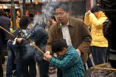 Spring Praying in China. In China, people would like to go to temples when spring comes. They pray to Buddha to bless them have a lucky future in the new year Royalty Free Stock Images