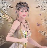 Spring queen. Beautiful fairy with iris in her hands Royalty Free Stock Image