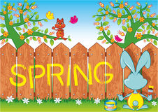 Spring. Rabbit wrote spring on a picket fence Stock Photos