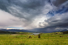 Spring rain and storm in mountains. Green spring hills of Slovak Stock Images