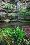Hidden Canyon Starved Rock State Park. Spring rains create a waterfall in Hidden Canyon of Starved Rock State Park in Illinois Stock Photo