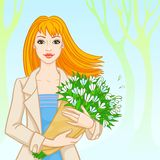 Spring. the red-haired woman with snowdrops Stock Photo