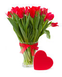 Spring red tulips in vase Royalty Free Stock Images
