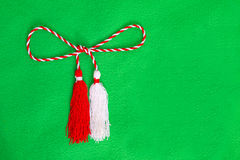 Spring red and white string. Isolated on green background Stock Photography