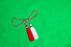 Spring red and white string. Isolated on green background Stock Images
