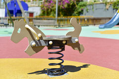 Spring rider in a playground Stock Photography