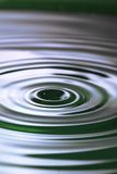 Spring ripple. A water surface with concentric ripples reflecting the colors of spring. Fresh, clean feel Royalty Free Stock Photo