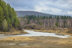Spring river on a background of mountains and forests. Spring river on a background of forests and mountains Stock Photography