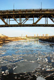 Spring river in edmonton. Spring view of city buildings and the north saskatchewan river with melting ice, edmonton, alberta, canada Royalty Free Stock Images