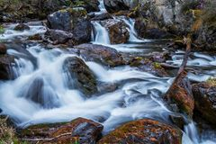 Spring river rapid flow in mountains. Somewhere deep within Altai mountains, Russia Stock Photo