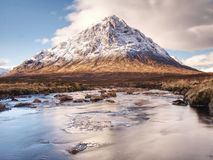 Spring river in Scottish highlands.  Dramatic landscape of Glen Coe Royalty Free Stock Photos