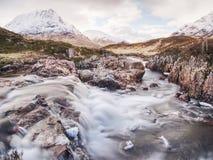 Spring river in Scottish highlands.  Dramatic landscape of Glen Coe Royalty Free Stock Photo