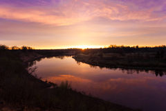 Spring. river. sunrise. sunset. Dawn over the river photographed in early spring Royalty Free Stock Image