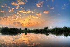 Spring river sunset. Beautiful sunset reflected in the river Angstel in the Netherlands in spring Stock Images