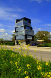 Spring roadside office building Royalty Free Stock Image