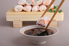Spring roll and chopsticks Stock Images