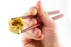 Spring roll on chopsticks Royalty Free Stock Image