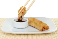 Spring roll in chopsticks Stock Photography