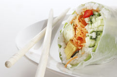 Spring roll and chopsticks Royalty Free Stock Images