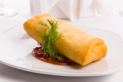Spring Roll Elegantly Complimented with Dill and Served on Sweet Stock Photos