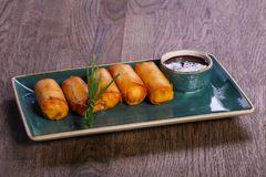 Spring roll with sauce. Served onion royalty free stock images