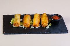 Spring roll with sauce. Spring roll with tomato sauce stock photography