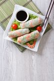 Spring roll with shrimp and sauce top view vertical Stock Photo