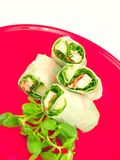 Spring rolls. Fresh chicken spring rolls in rice wrappers. Two back rolls are the focus point royalty free stock image