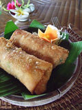 Spring rolls. Close up of spring rolls with flowers on a banana leave Royalty Free Stock Images