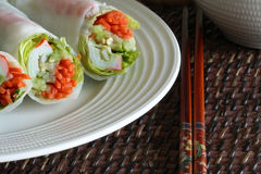 Spring Rolls. Crab and shrimp spring rolls with chopsticks royalty free stock photography