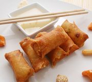 Spring rolls. Some asian spring rolls with a sauce of plum Stock Photo