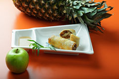 Spring rolls with apple and pineapple Royalty Free Stock Images