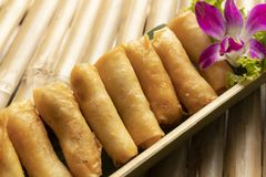Spring rolls on bamboo table royalty free stock image
