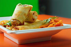 Spring rolls on a cafe table Royalty Free Stock Image