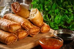 Spring rolls with chicken and vegetables on chopping board. Asian cuisine Royalty Free Stock Photography