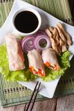 Spring rolls with chicken and vegetables vertical top view Stock Image