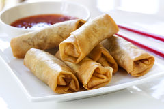 Spring Rolls with Chili Sauce. And chopsticks Stock Photos