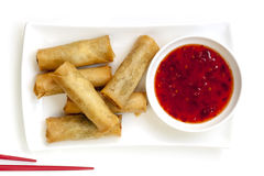Spring Rolls with Chili Sauce. And chopsticks.  Overhead view Royalty Free Stock Photo