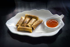 Spring rolls (Dim sum or Loempia), cuisine on the table. Stock Images
