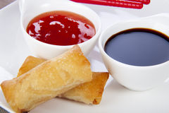 Spring Rolls and Dips. Freshly prepared Asian spring rolls appetizer Royalty Free Stock Photography