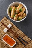 Spring rolls. Fresh spring rolls with vegetables in small chinnese dishware royalty free stock images