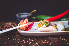 Spring rolls mean. On wood table top view Stock Photos