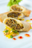 Spring Rolls. Plate with spring rolls and sweet-chilly sauce. Filled with vegetables and meat Royalty Free Stock Images