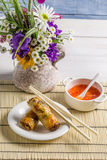 Spring rolls served with chili sauce Stock Photos