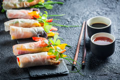 Spring rolls served with soy sauce on a stone plate Stock Image