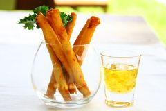 Spring rolls served with sweet and sour sauce in beautiful glass royalty free stock photos