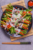 Spring rolls with vegetables and shiitake mushrooms on a plate. Stock Photography