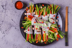 Spring rolls with vegetables and shiitake mushrooms on a plate. Stock Image